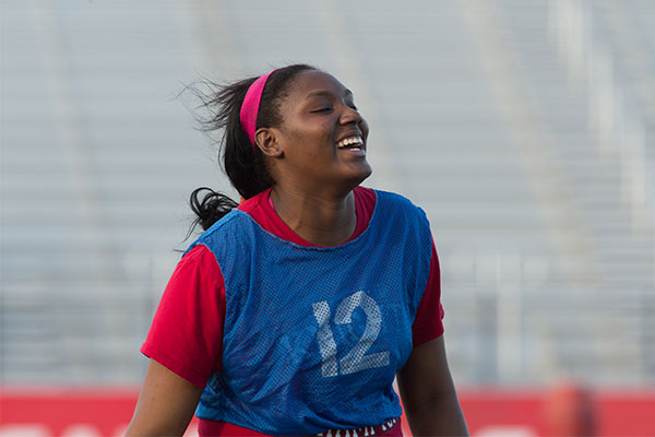 UIW Intramural Student Smiling while playing flag football