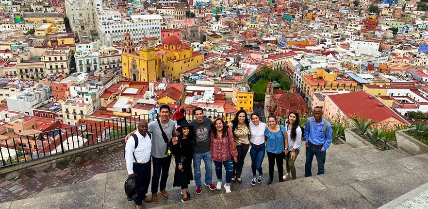 Students in front of Guanajuato, Mexico syline