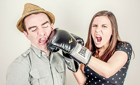stock image of woman punching man