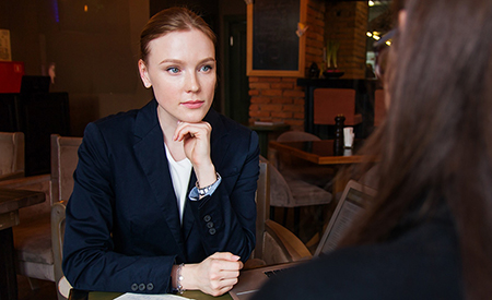 stock image of woman in meeting