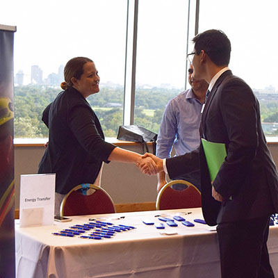 Student shakes hand with recruiter at career fair fall 2018