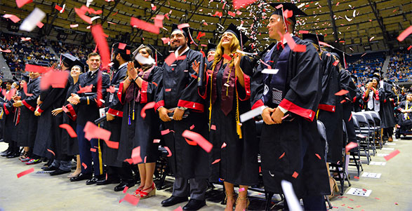 UIW students celebrating commencement with confetti