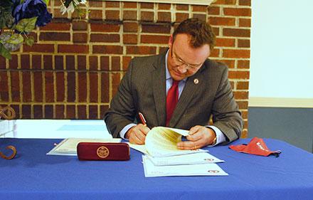 UIW President Dr. Thomas M. Evans signs Memorandums of Understanding