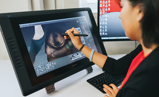 Animation and Game Design student works on a project